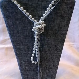 Express knotted metal and pearl necklace